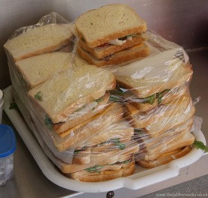 A tray of 20 or so club toasties - bacon, chicken, rocket and cheddar before cooking