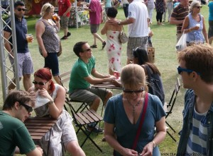 Probably a coincidentally large number of people wearing sunglasses in one picture. some are also eating toasties at the brand new Jabberwocky tables.