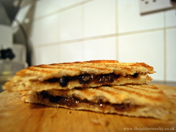 A sliced Christmas toastie filled with mincemeat.