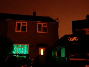 The Beast's green lights have moved into our living room and now illuminate the Beast as he bides his time on the drive