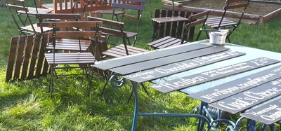 A jumble of chairs and a table of blackboards