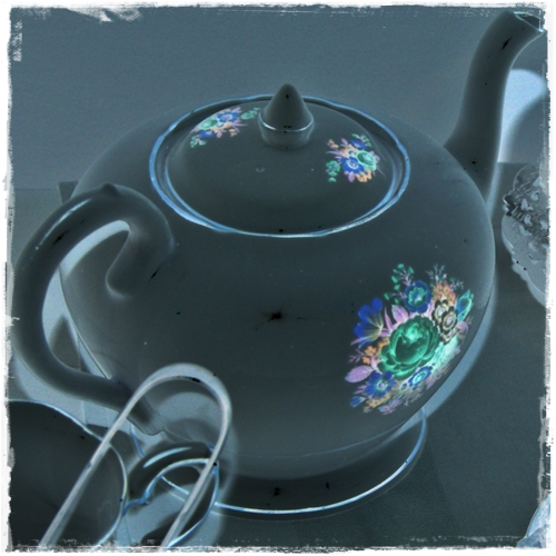 A teapot, as a film negative.