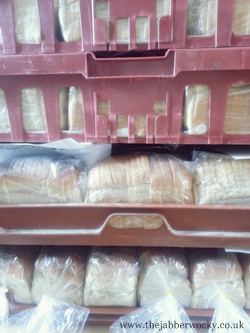 Bread stacked in red bakery crates
