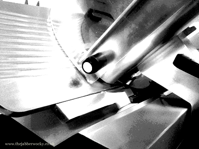 A black and white picture of our meat slicer.
