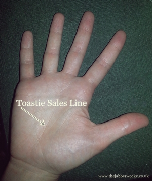 "A hand with the ""toastie sales line"" highlighted"