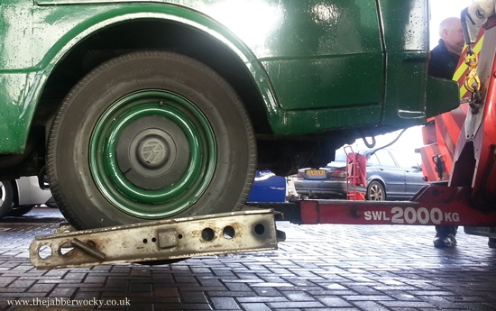 The front wheels of our food truck, as he gets a tow.