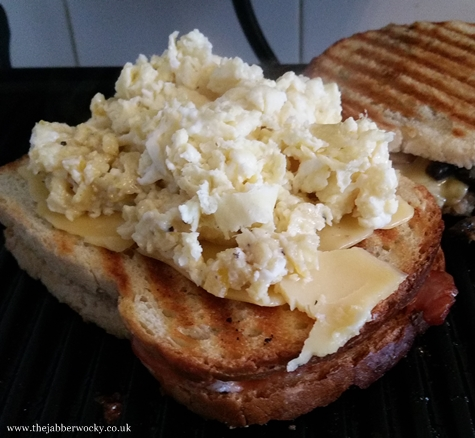 Full monty breakfast toastie with scrambled egg