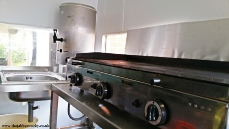 The griddle, the tea urn and the sink.