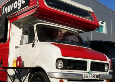 Our red and white Bedford van