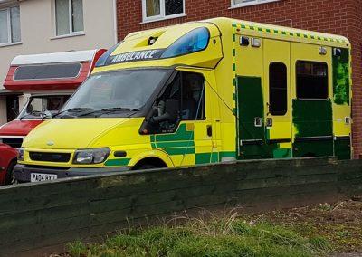 A box-backed ambulance on our driveway.